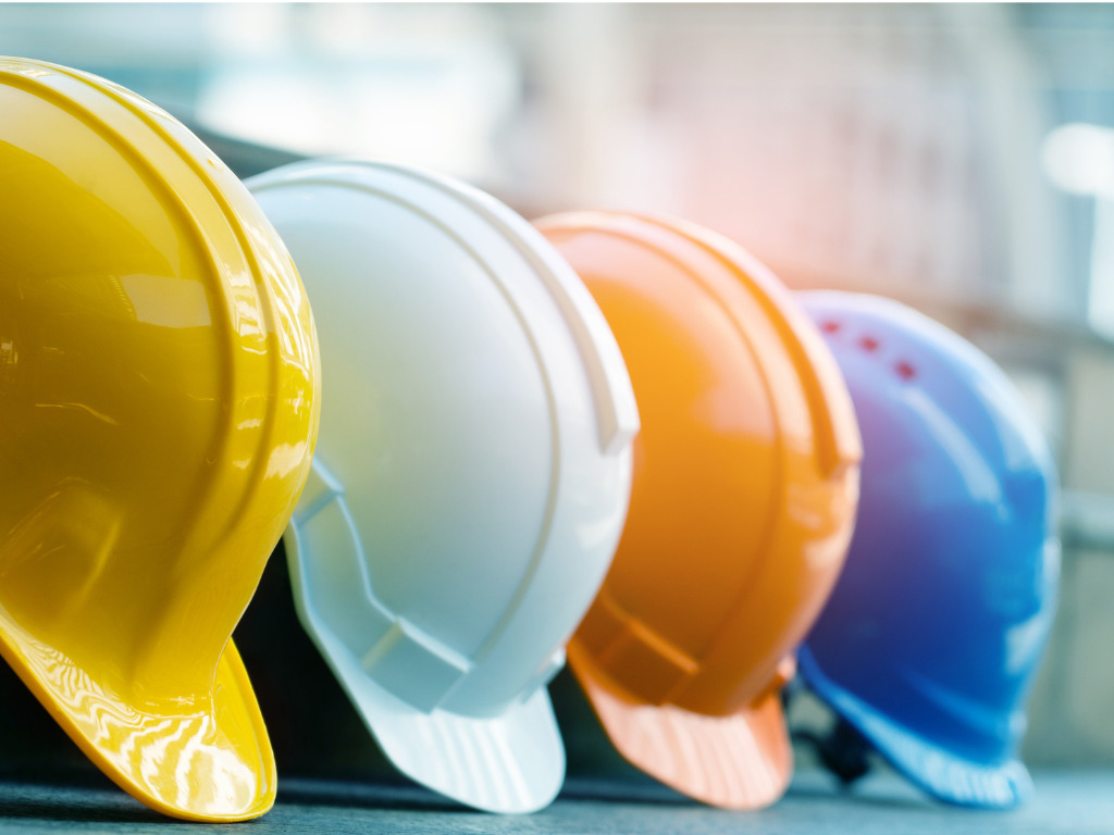 safety construction worker hats blue white yellow orange teamwork of picture id1205863144