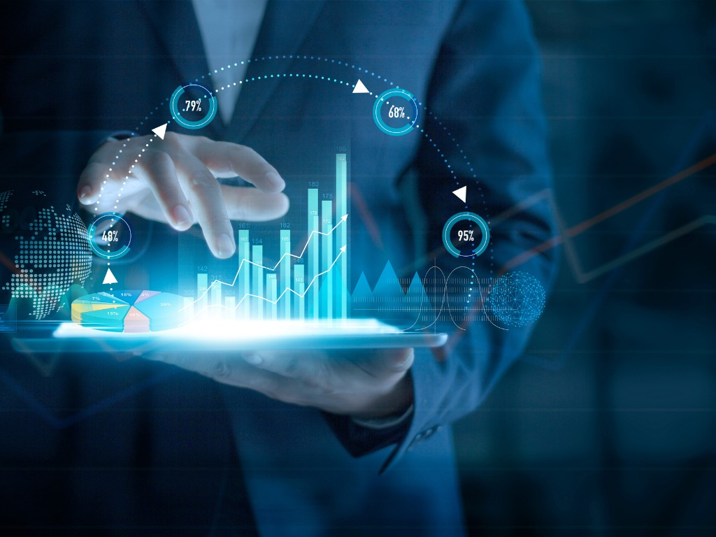 businessman using tablet analyzing sales data and economic growth picture id1250153439