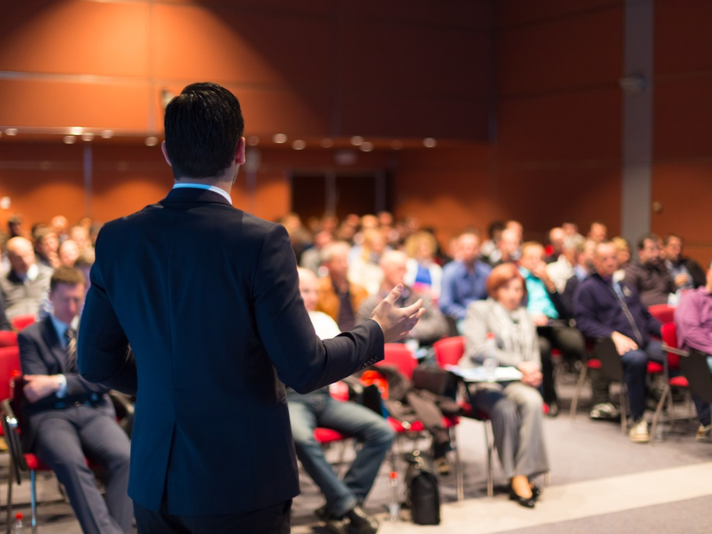 man speaking at a business conference picture id499517325