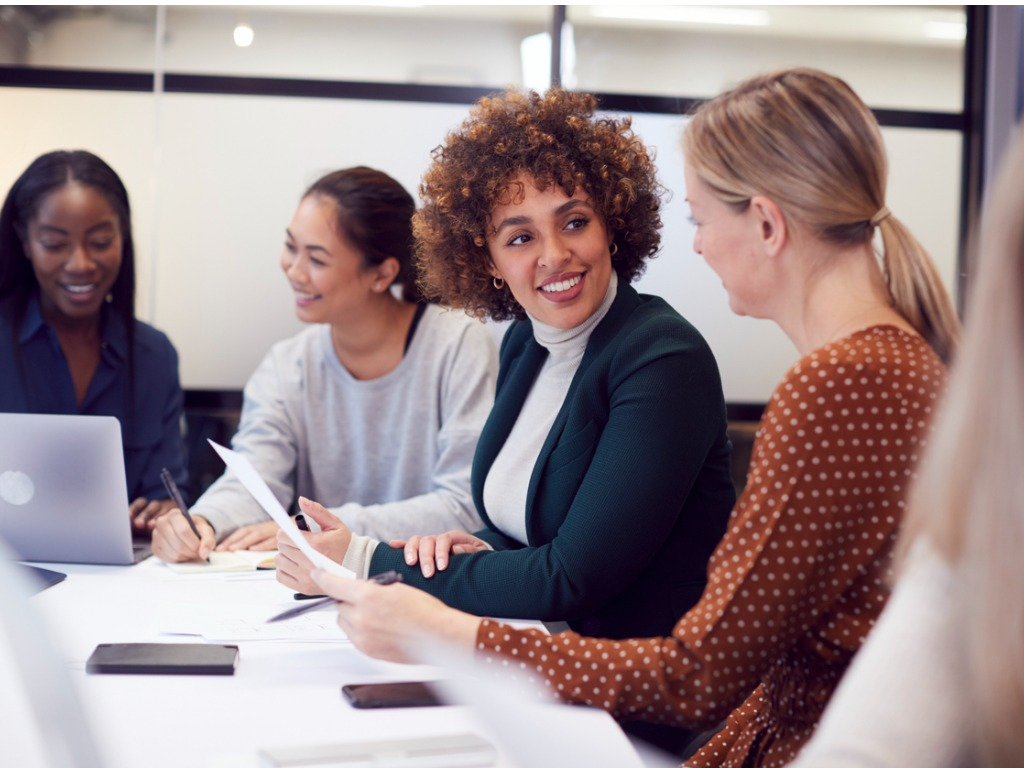 group of businesswomen collaborating in creative meeting around table picture id1279113943 2