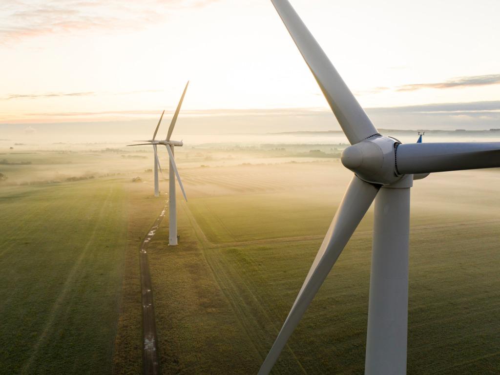 three wind turbines at sunrise picture id1288129103